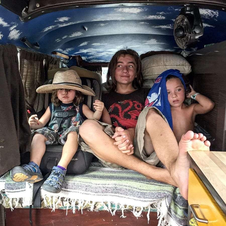 children riding in a Volkswagen Bus