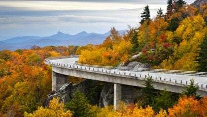 A portion of the Blue Ridge Parkway as it winds around a mountain curve in Autumn