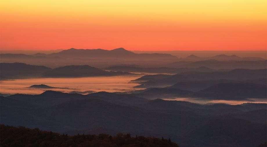 Sunrise over North Carolinian Mountains and a lake