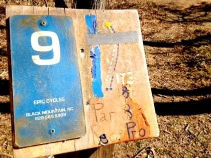 The placard mapping out hole nine of the Black Mountain Disc Golf Course