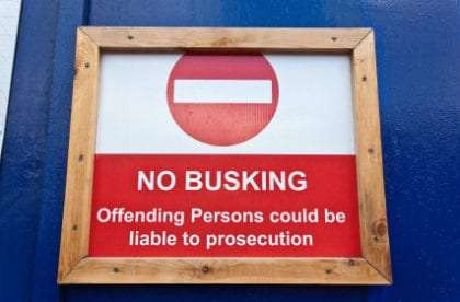 Sign reading: No Busking Offending Persons could be liable to prosecution