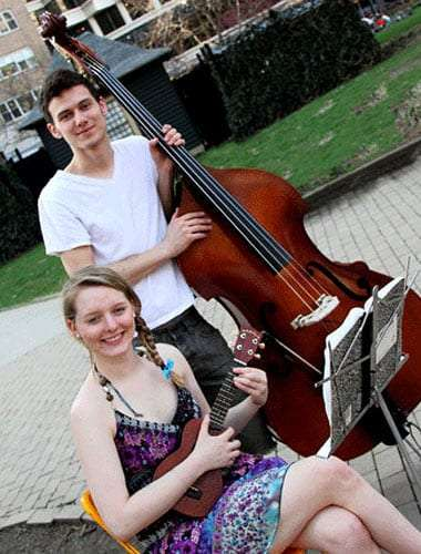 Olive Juice Band members Nick Rahn, with his standup base, and Danielle Lovier, holding her ukulele