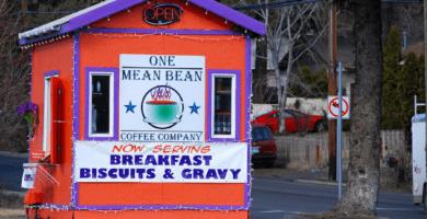 an orange and purple coffee shack