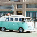 a turquoise and white vintage VW Bus