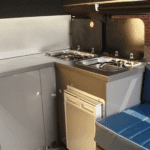 the inside of a converted Ford van