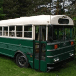 a green and white school bus conversion