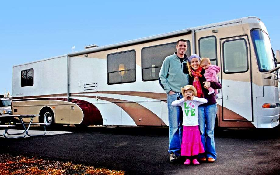The Janssens in their RVing days, standing in front of their rig
