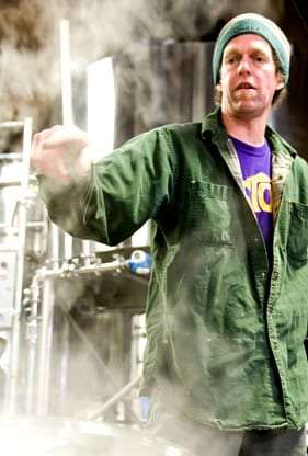 brewer Jack Harris enveloped in steam, at work in the Fort George Brewery