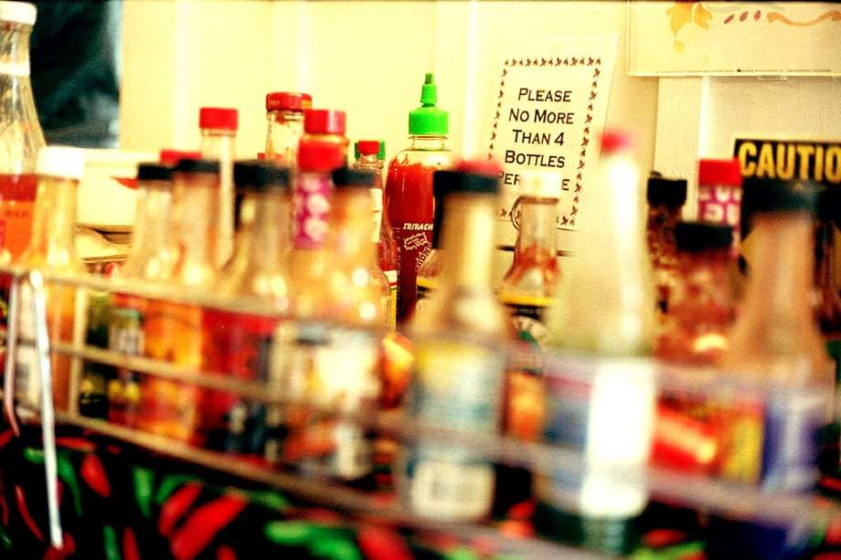 an assortment of hot sauce bottles