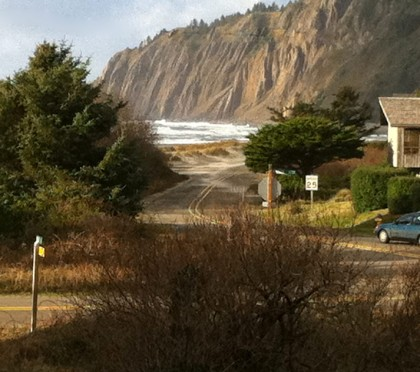 A road leading into the Manzanita neighborhood of Neahkahnie, the ocean and mountains abound
