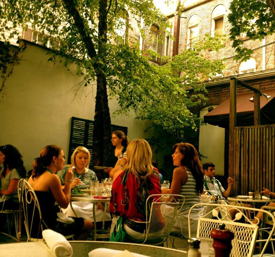four women enjoying tapas at Just a Taste in the back patio area