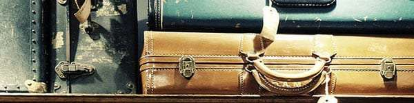 vintage suitcases stopped one atop the other