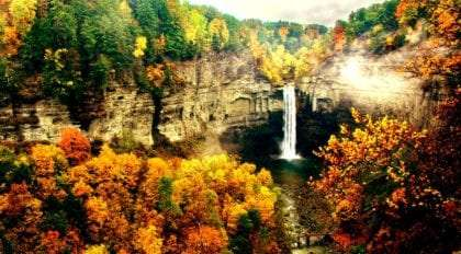 taughannock falls pours over the gorge in the brilliance of autumn
