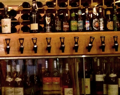 wine bottles and wine taps, along with some imported beer bottles