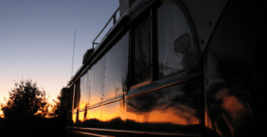 sunset reflecting in the side of an RV