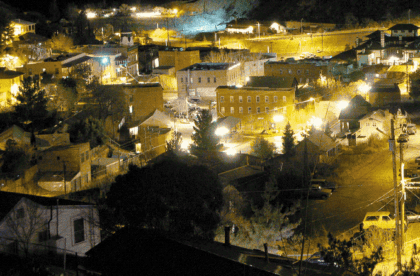 the town of Bisbee, at night, lit up like a Christmas Tree, almost literally