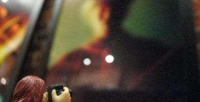 a toy zartan gi joe perhaps taking a photograph of a photograph of a man wearing a hat, blurry