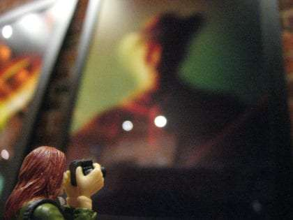 a toy zartan gi joe perhaps taking a photograph of a photograph of a man wearing a hat, blurry