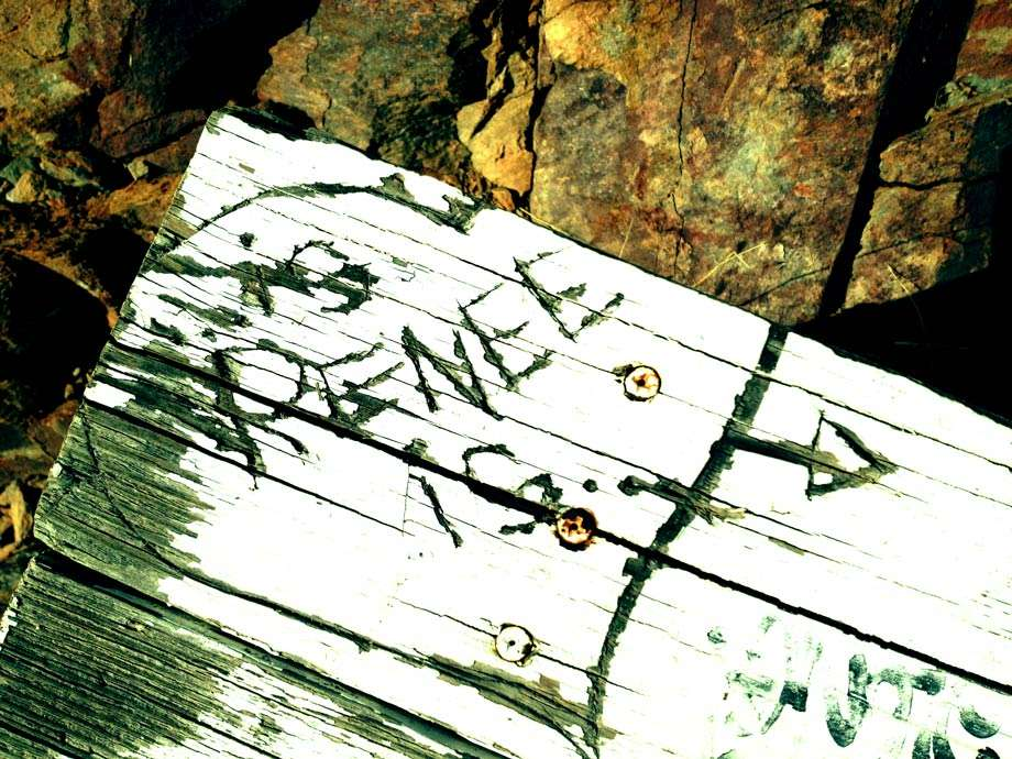 a painted white bench with the words is Renee is carved inside of a heart