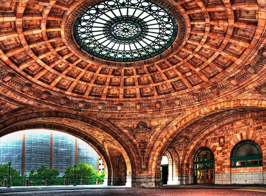 a large, copper dome, a former train station