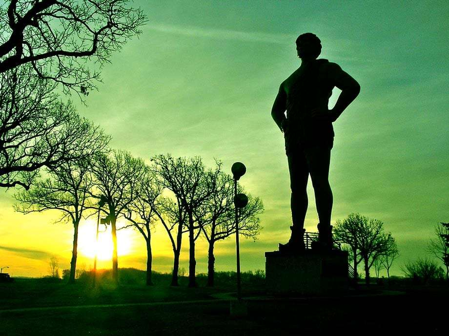the silhouette of the Jolly Green Giant as a massive statue