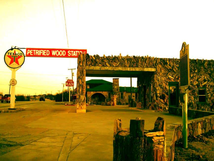 a gas station covered in petrified wood