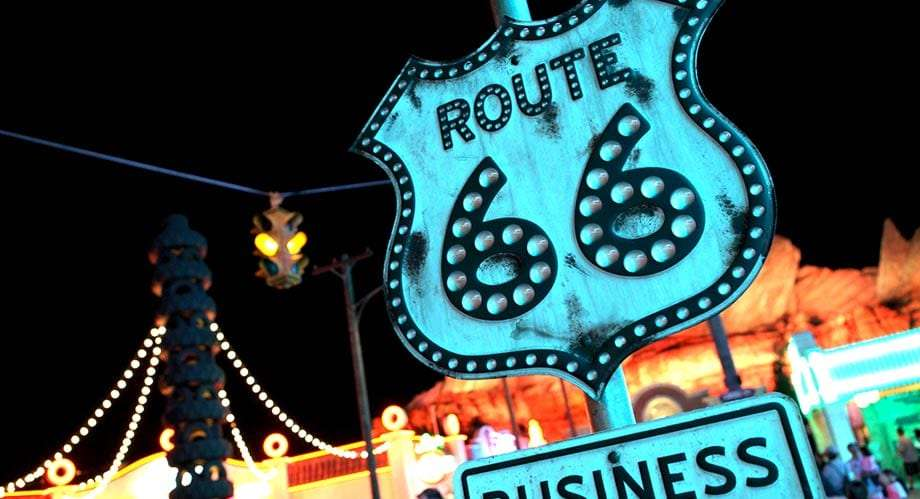 old route 66 sign against a carnival background