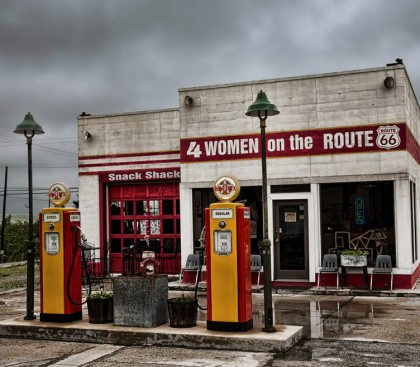 a white brick building, red and yellow trim, reads 4 Women on the Route 66