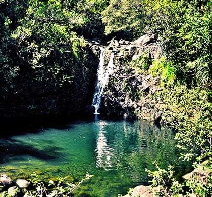 green and blue, a pond waterfalls into