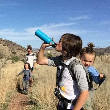 three boys hiking with their mama