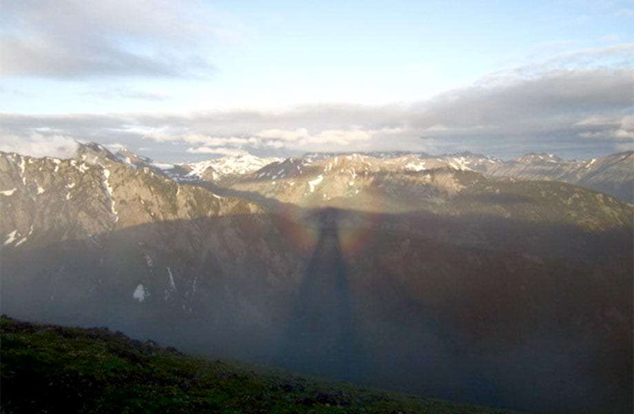 view from mt. townsend at sunrise this is a phenomenon known as the brocken spectre  the low stratus clouds reflect your ghostly shadow in a prism of colors for what looks like miles away!!!!