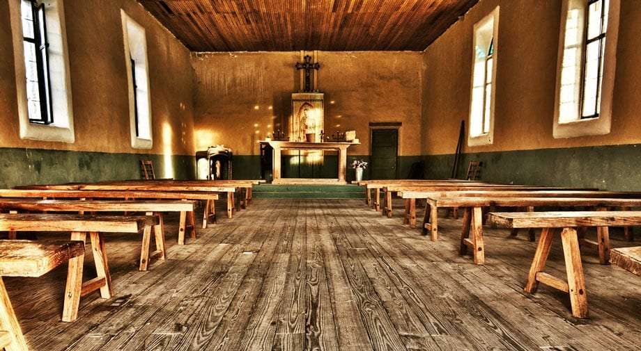 the inside of an old, wooden church