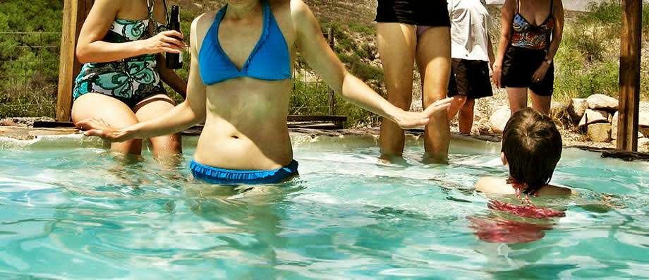 young girls swimming in a crystal blue pool