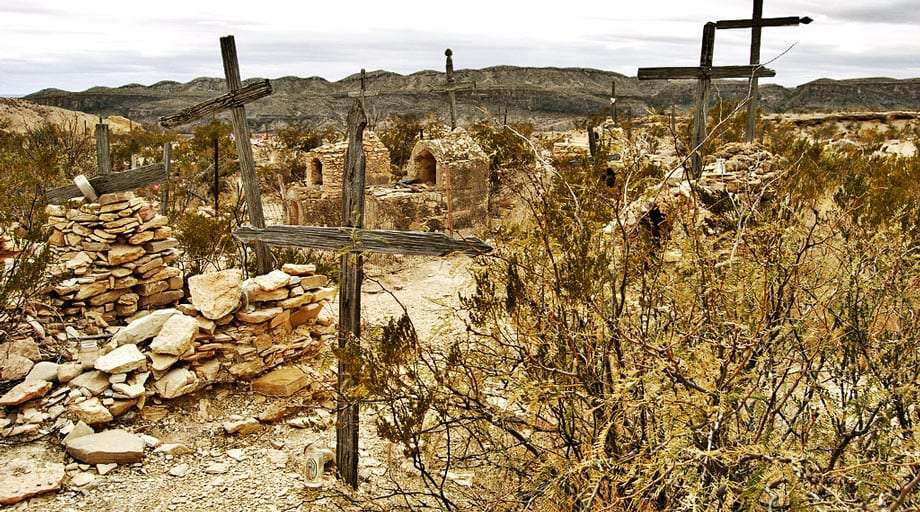wooden crosses serving as gravestones in the still used graveyard in Terlingua