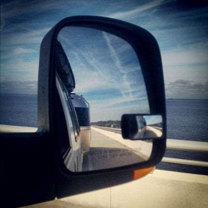 the Gulf of Mexico, and an Airstream, in a rearview mirror