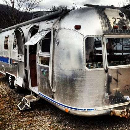 a 1976 Airstream shining in the Ashevillian winter