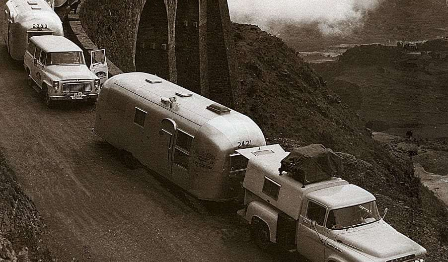 A caravan of Airstreams shinging, traveling across Africa