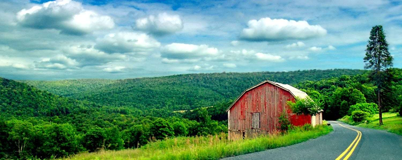 farm in rolling green hills