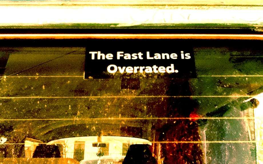 a sticker on a volkswagen bus reads The Fast Lane is Overrated