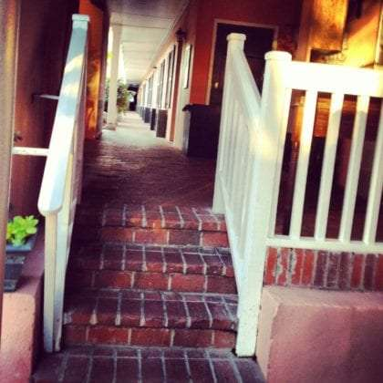 red brick stairs welcome you to a hotel in the historic district of charleston