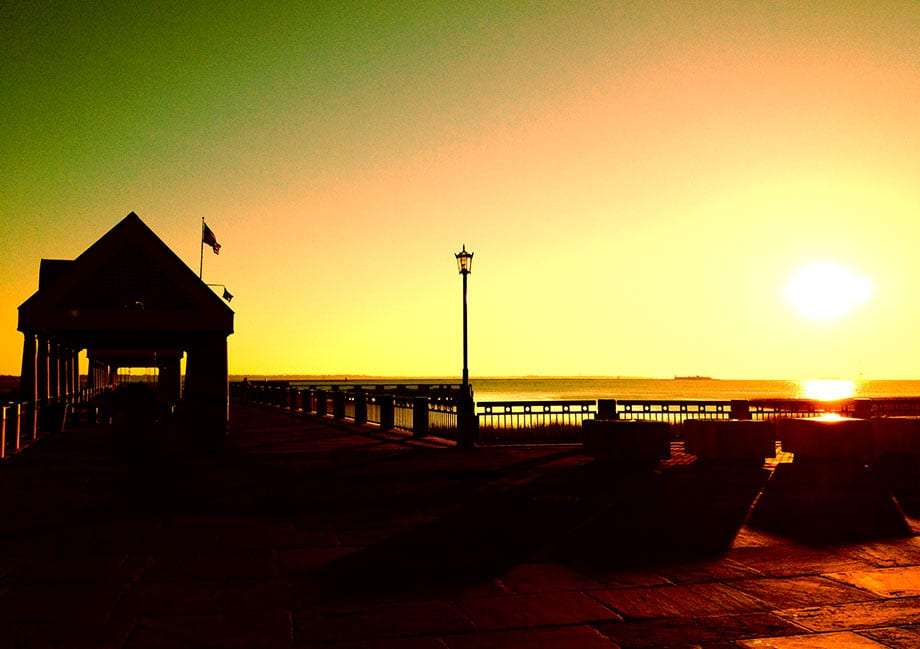 sunrise over a pier at charleston