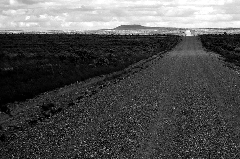 an endless, desolate dirt road through Idaho