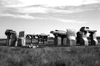 cars stacked to resemble stonehenge