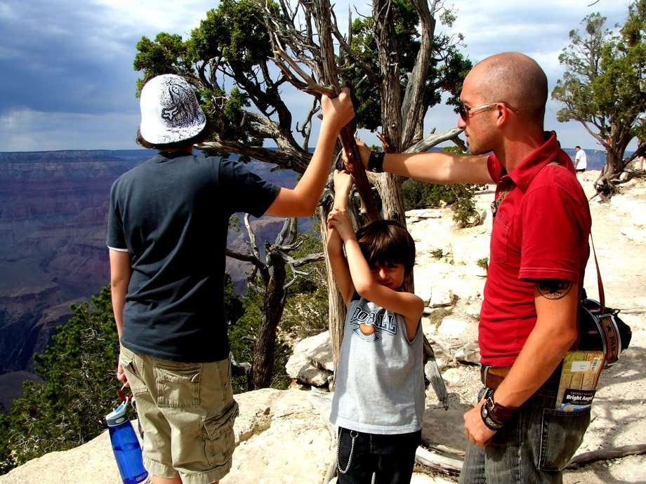 three guys, a 7 year old, 15 year old and 33 year old, look over the grand canyon