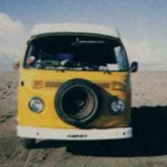 a vintage, yellow, 1970s Volkswagen Bus