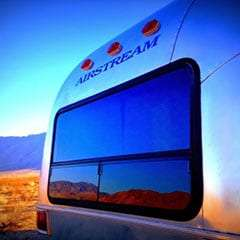 an airstream reflecting beautifully the desert