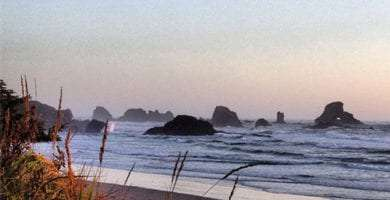 stacks rise from the Pacific Ocean as it crashes into Indian Beach, Oregon