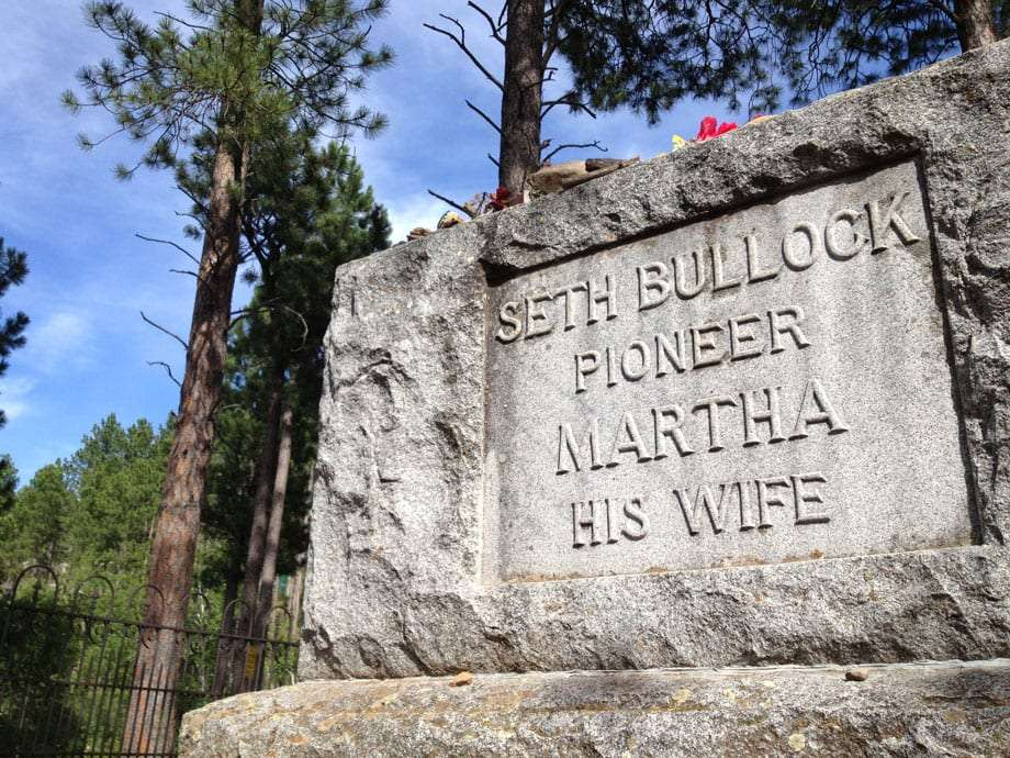 a gravestone reads Seth Bullock, pioneer, Martha, his wife