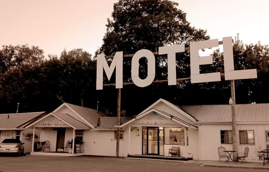 a motel with a giant sign proclaiming just that