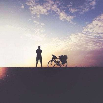 silhouette of a man and his bike